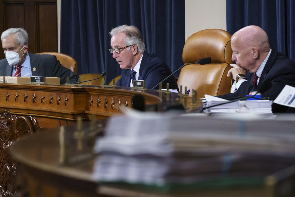 House Ways and Means Committee Chairman Richard Neal, D-Mass., center, flanked by Rep. Lloyd Doggett, D-Texas, left, and Rep. Kevin Brady, R-Texas, the ranking member, right, make opening statements as the tax-writing panel continues work on the Democrats' sweeping proposal for tax hikes on big corporations and the wealthy to fund President Joe Biden's $3.5 trillion domestic rebuilding plan, at the Capitol in Washington, Tuesday, Sept. 14, 2021. (AP Photo/J. Scott Applewhite)