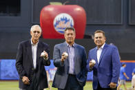 New York Mets Hall of Fame inductees Ron Darling, right, pitcher Jon Matlack, center, and infielder Edgardo Alfonzo pose for a photo during the induction ceremony, Saturday, July 31, 2021, in New York. (AP Photo/Mary Altaffer)