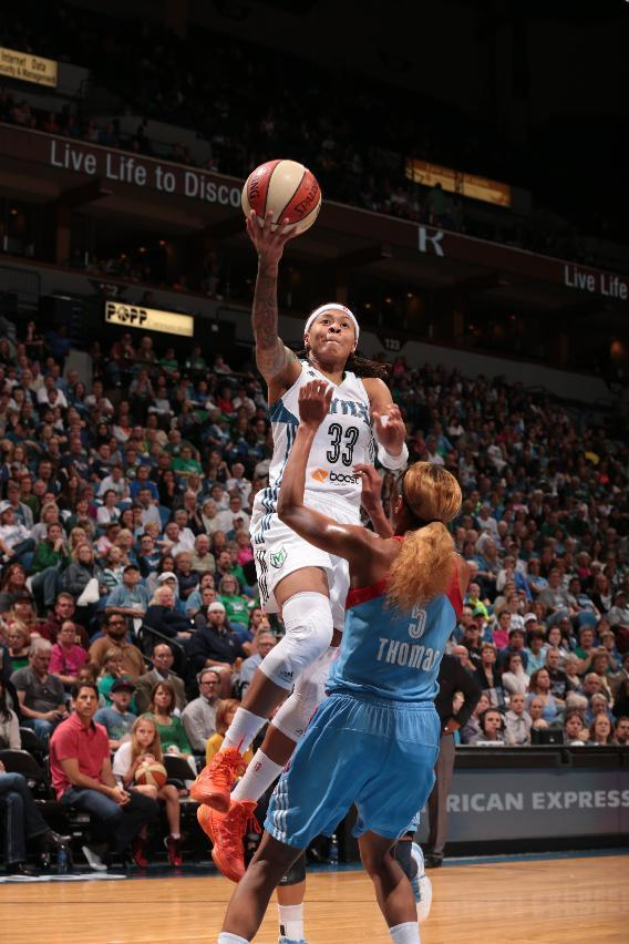 MINNEAPOLIS, MN - OCTOBER 8: Seimone Augustus #33 of the Minnesota Lynx goes in for a layup against Jasmine Thomas #5 of the the Atlanta Dream during Game 2 of the 2013 WNBA Finals on October 8, 2013 at Target Center in Minneapolis, Minnesota. (Photo by Jordan Johnson/NBAE via Getty Images)