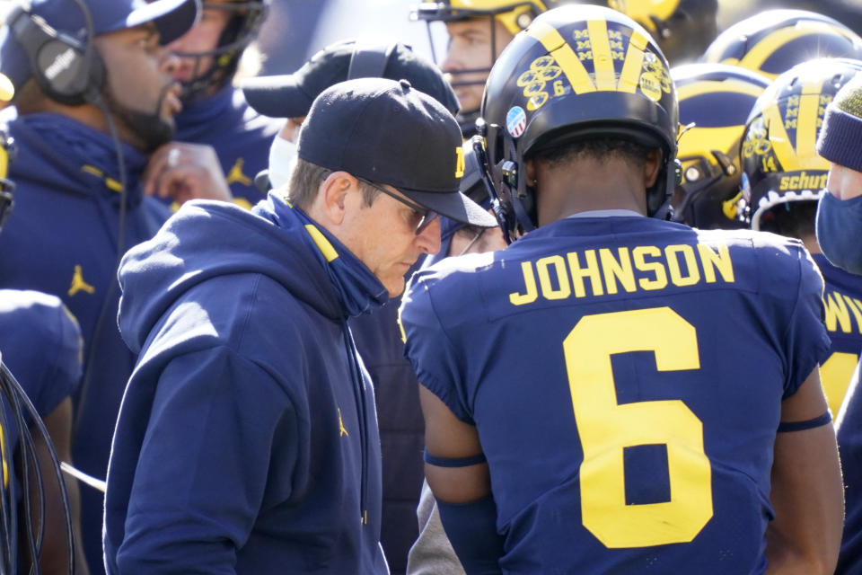 Michigan head coach Jim Harbaugh on the sidelines during the first half of an NCAA college football game, Saturday, Oct. 31, 2020, in Ann Arbor, Mich. (AP Photo/Carlos Osorio)