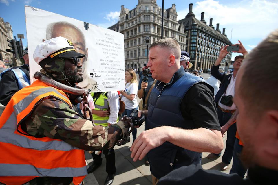 Paul Golding shakes hands with a fellow protester (PA)