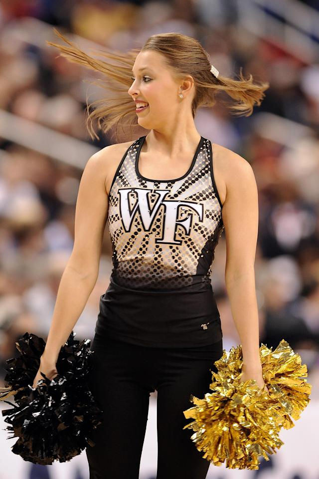 GREENSBORO, NC - MARCH 14: A cheerleader of the Wake Forest Demon Deacons performs during a game against the Maryland Terrapins during the first round of the 2013 Men's ACC Tournament at the Greensboro Coliseum on March 14, 2013 in Greensboro, North Carolina. Maryland defeated Wake Forest 75-62. (Photo by Lance King/Getty Images)