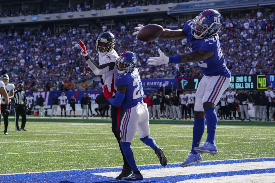 New York Giants cornerback James Bradberry (24) misses a potential intercept on a pass intended for Atlanta Falcons tight end Kyle Pitts, center left, in the end zone during the second half of an NFL football game, Sunday, Sept. 26, 2021, in East Rutherford, N.J. (AP Photo/Seth Wenig)