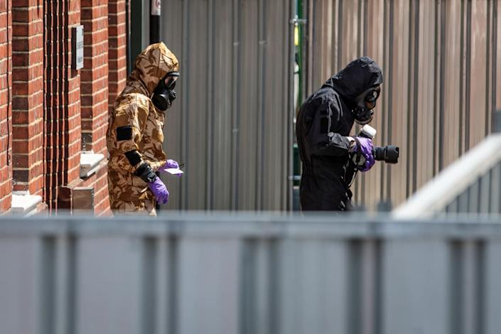 """<div class=""""inline-image__caption""""><p>Emergency workers in protective suits search a house in Salisbury, England, after a man and woman were exposed to the deadly Novichok nerve agent in July 2018, several months after the poisoning of the former Russian spy Sergei Skripal and his daughter, Yulia, in the same town.</p></div> <div class=""""inline-image__credit"""">Jack Taylor/Getty Images</div>"""