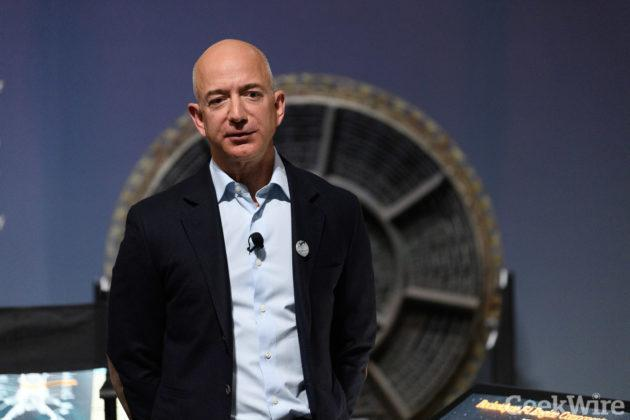 """Jeff Bezos talks with students at the opening of the """"Apollo"""" exhibit at the Museum of Flight. (GeekWire Photo / Kevin Lisota)"""