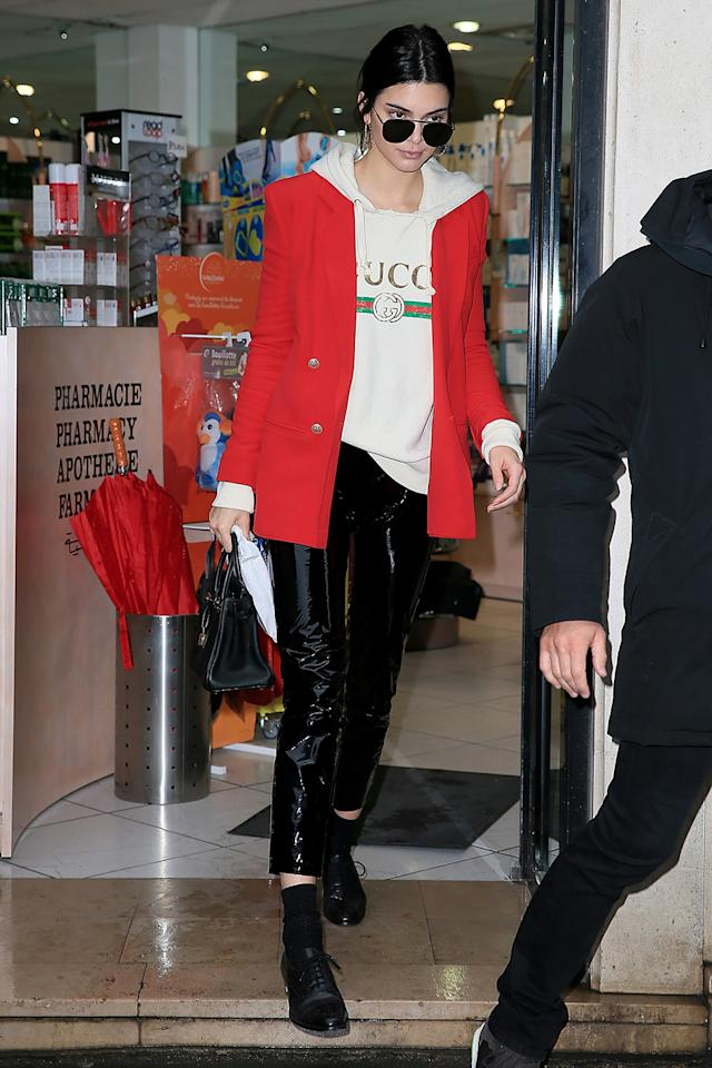 <p>Kendall Jenner is a fan of logo embossed Gucci apparel. She wore the brand's $1,720 appliquéd hoodie with a red blazer and black patent pants during Paris Fashion Week in March 2017. (Photo by Pierre Suu/GC Images) </p>