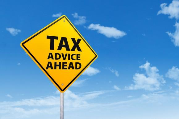 road sign that says tax advice ahead