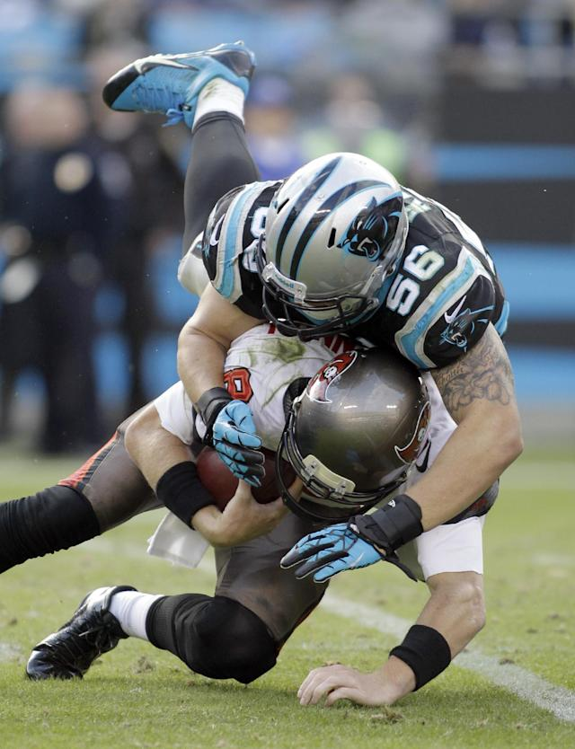 Carolina Panthers' A.J. Klein (56) sacks Tampa Bay Buccaneers quarterback Mike Glennon (8) in the second half of an NFL football game in Charlotte, N.C., Sunday, Dec. 1, 2013. (AP Photo/Bob Leverone)