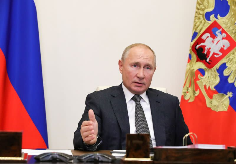 Russian President Vladimir Putin takes part in a meeting with elected heads of Russian regions, via video link outside Moscow