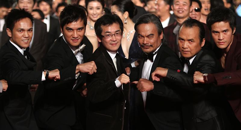 "Taiwanese director Wei Te-sheng, third from left, and Taiwanese actors of the movie ""Warriors of the Rainbow: Seediq Bale"" Bokeh Kosang, first left, and Lin Ching-tai, forth left, pose with other actors at the 48th Golden Horse Awards, Saturday, Nov. 26, 2011, in Hsinchu, northern Taiwan. Wei is nominated for Best Director of the film "" Warriors of the Rainbow: Seediq Bale "" at this year's Golden Horse Awards -one of the Chinese-language film industry's biggest annual events. (AP Photo/Chiang Ying-ying)"