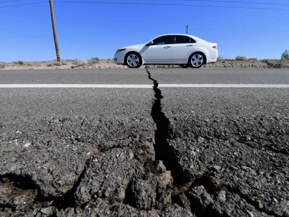 A car drives past a crack in the road on Highway 178, south of Trona, after a 6.4-magnitude earthquake hit in Ridgecrest, California (AFP/Getty Images)