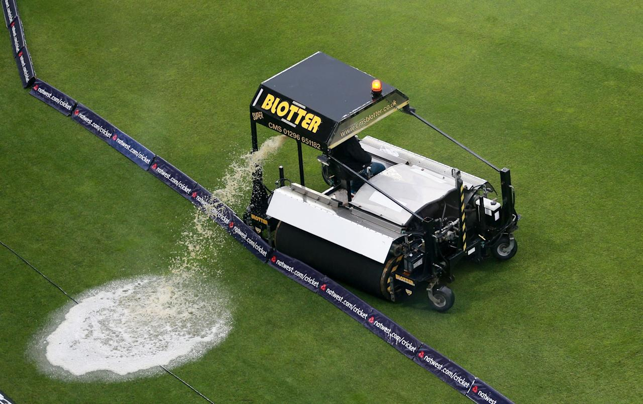 A 'Blotter' clears water from the outfield during the Third One Day International at Edgbaston, Birmingham.