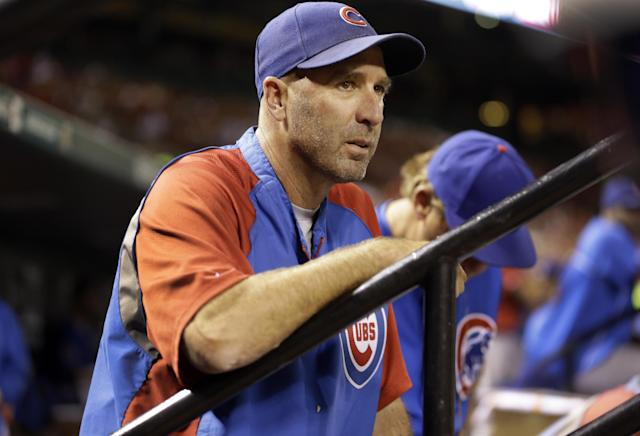 Chicago Cubs manager Dale Sveum watches from the dugout during the first inning of a baseball game against the St. Louis Cardinals Friday, Sept. 27, 2013, in St. Louis. (AP Photo/Jeff Roberson)