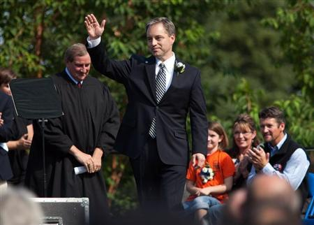 Newly inaugurated Alaska Governor Sean Parnell waves to crowd after being sworn in at the annual Governor's Picnic in Fairbanks
