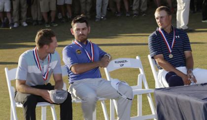 Dustin Johnson's chair sat empty during the U.S. Open awards ceremony. (AP)