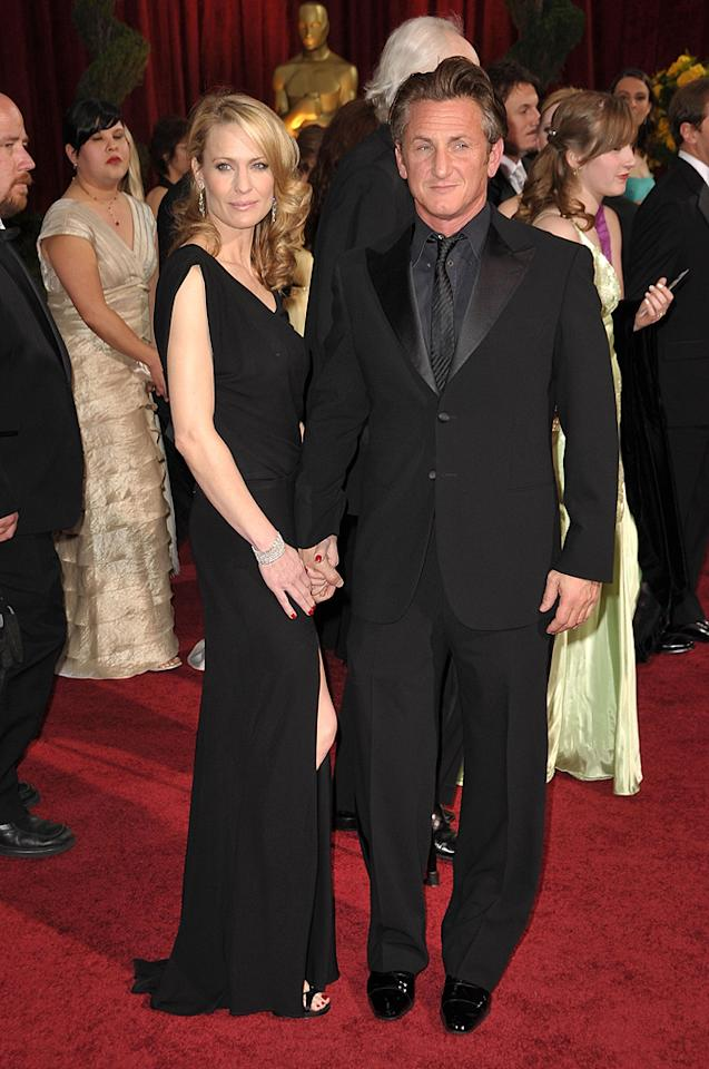 Robin Wright Penn and Sean Penn    Grade: B+       The Best Actor winner wore a Giorgio Armani suit, while his wife stepped out in a sexy Monique Lhullier looker.
