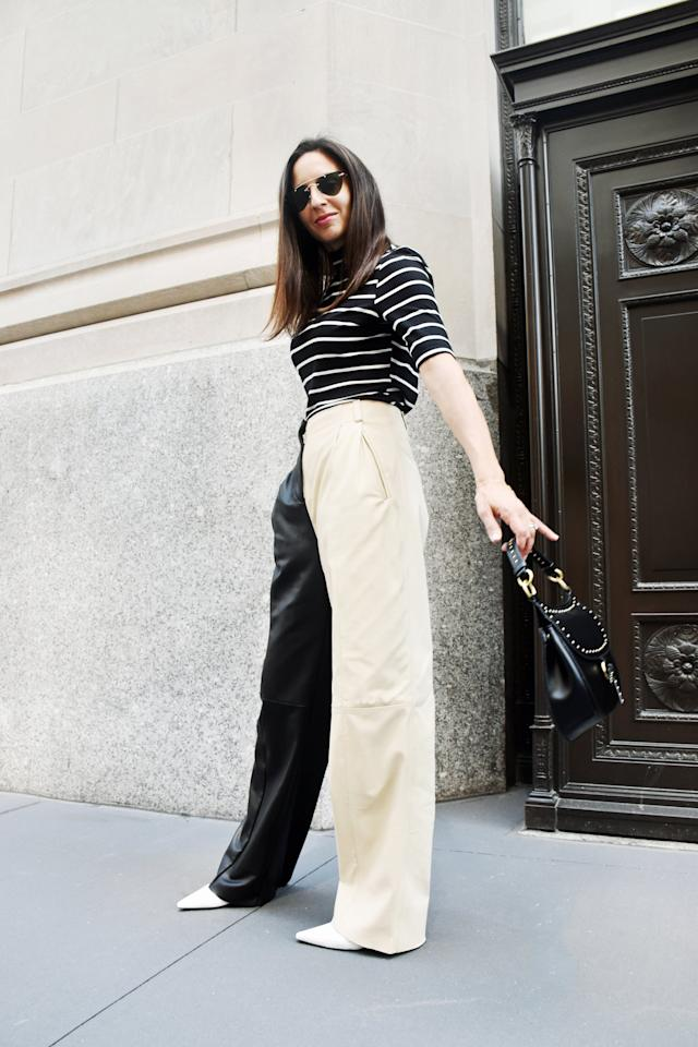 <p>Sharp sunglasses and a studded bag lend a edgy-yet-polished touch. </p> <p><em>On Dana: POPSUGAR at Kohl's top, Veda leather pants, Stuart Weitzman boots, a Zara bag, and Illesteva sunglasses.</em></p>