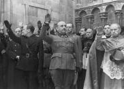 FILE, In this Nov. 20, 1938 file photo, former Spanish dictator Francisco Franco, centre, attends the second anniversary of the death of Jose Antonio Primo de Rivera, the founder of the Spanish right-wing movement La Falange, in Burgos, Spain. Spain says it has exhumed the remains of Spanish dictator Gen. Francisco Franco from his grandiose mausoleum outside Madrid so he can be reburied in a small family crypt north of the capital. (AP Photo)