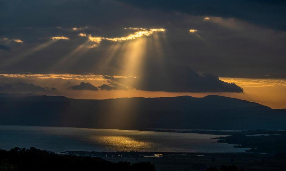 Rays of sunshine cast a golden glow on the world's lowest freshwater lake