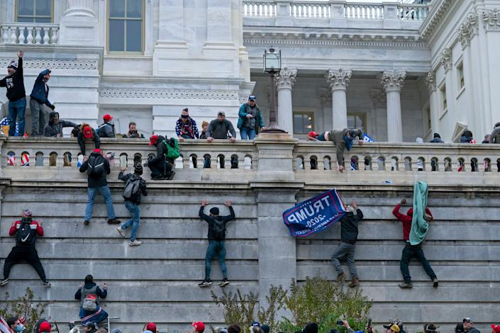 In this Jan. 6, 2021 file photo, rioters climb the west wall of the the U.S. Capitol in Washington. (Copyright 2020 The Associated Press. All rights reserved)