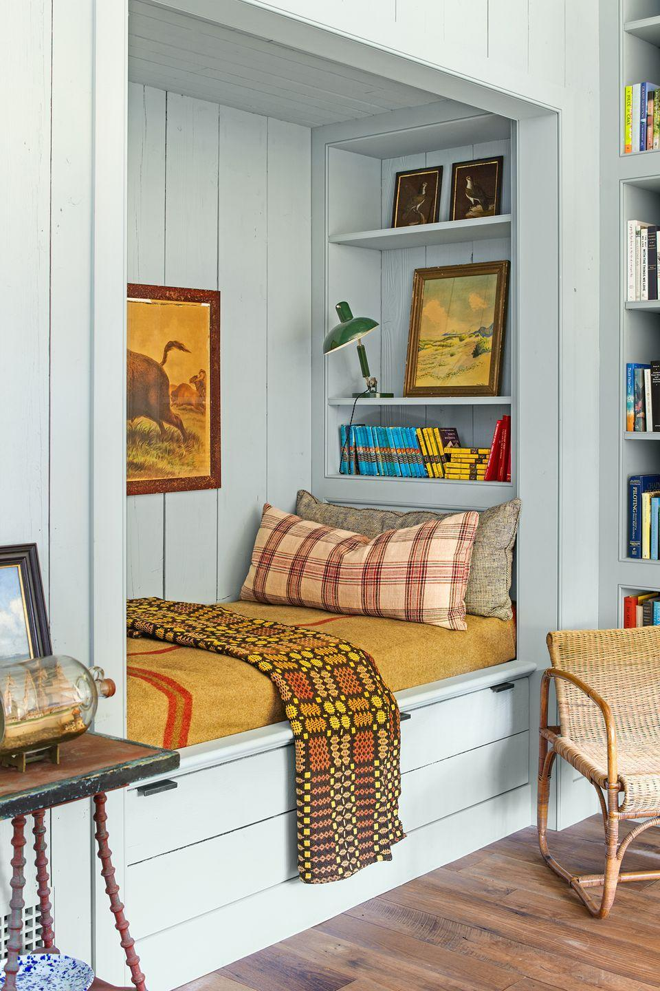 <p>This built-in bed, featuring an attractive pastel blue hue, offers ample storage for books and artwork. </p>