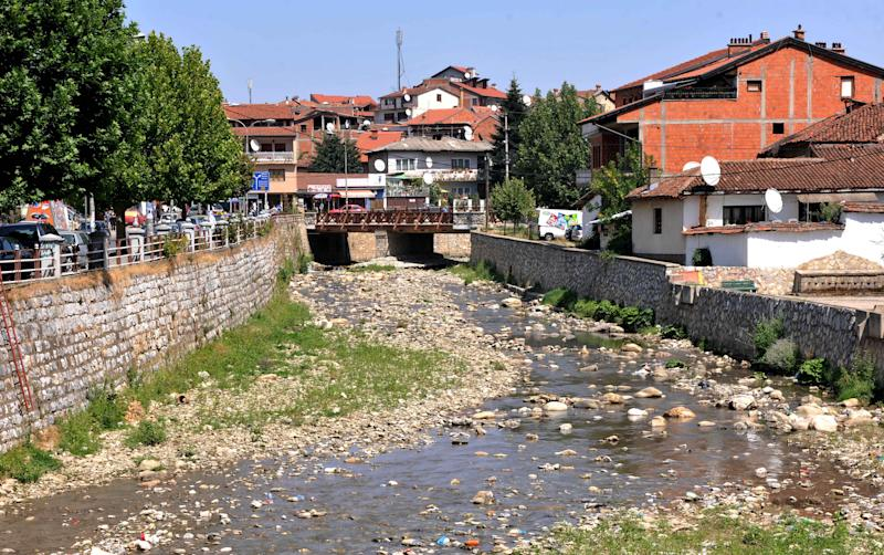 This Wednesday, Aug. 22, 2012 photo shows the almost dried out Bistrica river in western Kosovo town of Prizren. Fires are raging, rivers are reduced to a trickle, crops are dry, wells are empty and hydropower plants are shutting down production. After the harshest winter in decades, the Balkans is now facing its worse drought in 40 years. The record-setting temperatures, which scientists say is a result of global warming, have devastated food and electricity production in the southeastern region of Europe, which is already suffering under a deep economic crisis. ( AP Photo / Visar Kryeziu )