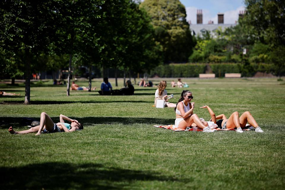 People enjoy the sunshine in Hyde Park in London where temperatures rose to scorching levels (AFP/Getty)