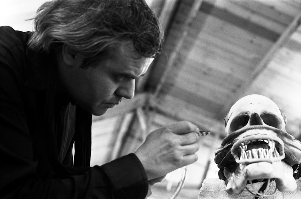 Giger at work on the Xenomorph in his studio (Photo: Courtesy of and ©2021 Museum HR Giger)