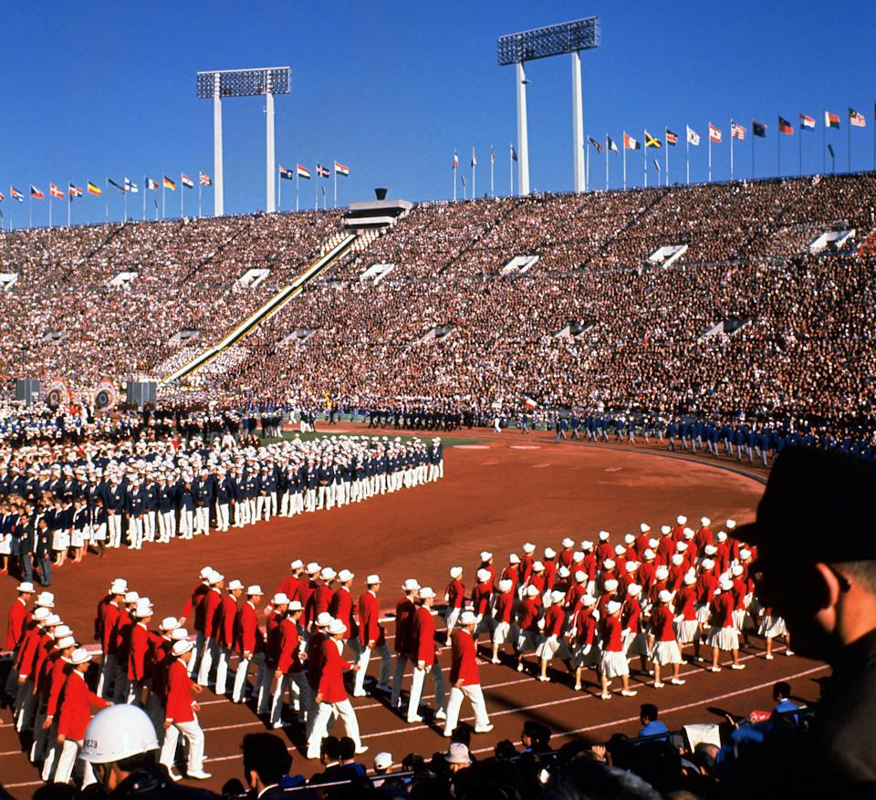 (FILES) Photo taken 10 October 1964 shows the opening ceremony of Tokyo Olympic Games at Tokyo's national stadium. Tokyo is making a head start bidding for the 2016 Summer Olympics, with its nationalist leader hoping to restore some of the glory of Japan's first Games after Beijing showcases China's rise in 2008. Japan, which is emerging from a decade-long economic slump, has become the first nation to formally inform the International Olympic Committee (IOC) of its candidacy for the 2016 Games which won't be decided until mid-2009.    AFP PHOTO/JIJI PRESS (Photo by STR / JIJI PRESS FILES / AFP) / Japan OUT        (Photo credit should read STR/AFP via Getty Images)