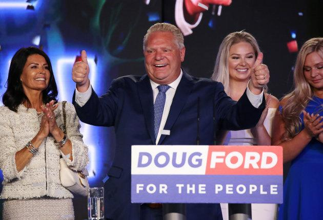 Progressive Conservative leader Doug Ford attends his election night party with his wife Karla Ford and their daughters following the provincial election in Toronto on June 7, 2018.