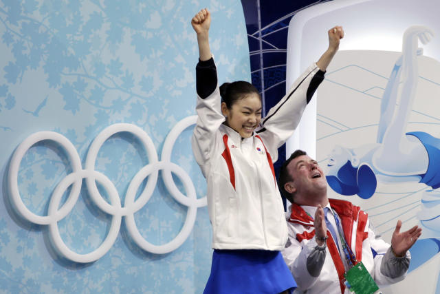 FILE – In this Feb. 25, 2010, file photo, South Korea's Kim Yu-Na, left, and her coach Brian Orser, right, react after she received her scores for her free skate program in the women's figure skating competition at the Vancouver 2010 Olympics in Vancouver, British Columbia. (AP Photo/Ivan Sekretarev, File)