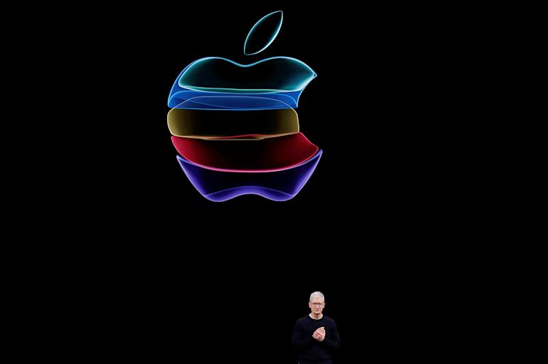 FILE PHOTO: CEO Tim Cook speaks at an Apple event at their headquarters in Cupertino