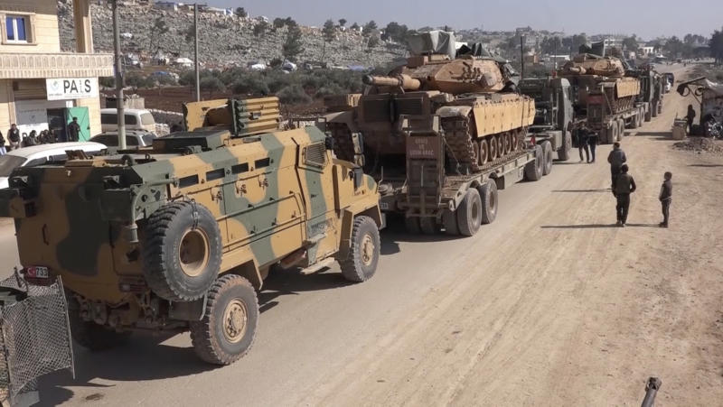 In this frame grab from video taken on Sunday, Feb. 2, 2020, a Turkey Armed Forces convoy is seen at the northern town of Sarmada, in Idlib province, Syria. A large Turkish military convoy moved into the rebel-held areas of northwest Syria on Sunday, witnesses on the ground said, adding it appeared to be heading towards the south of Idlib province. (AP Photo/APTN)