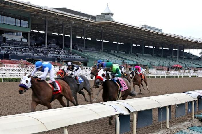 ARCADIA, CALIF. -- SATURDAY, MARCH 14, 2020: Time for Suzzie, ridden by Jorge Velez, crosses the finish line in first place in the first race at Santa Anita Park in Arcadia, Calif., on March 14, 2020. The track is closed to fans due to the coronavirus, but the horses are still running. (Gary Coronado / Los Angeles Times)