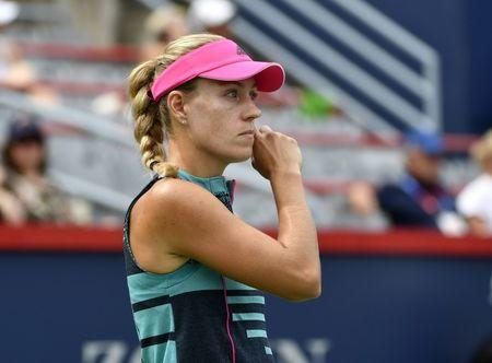 Aug 8, 2018; Montreal, Quebec, Canada; Angelique Kerber of Germany reacts after a point in her match against Alize Cornet of France (not pictured) in the Rogers Cup tennis tournament at Stade IGA. Mandatory Credit: Eric Bolte-USA TODAY Sports
