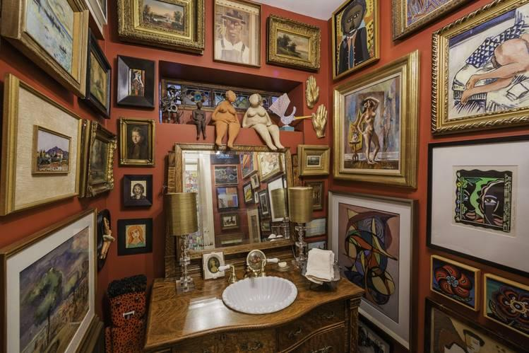 Te downstairs powder room in Robert Alter and Sherry Siegel's home in Chicago features over five dozen works of art.