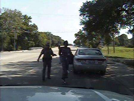 FILE PHOTO: Texas state trooper Brian Encinia points a Taser as he orders Sandra Bland out of her vehicle, in this still image captured from the police dash camera video from the traffic stop of Bland's vehicle in Prairie View, Texas, U.S. on July 10, 2015.    Courtesy Texas Department of Public Safety/Handout via REUTERS/File Photo