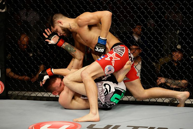 SAN JOSE, CA - APRIL 20: Jorge Masvidal (top) punches Tim Means in their lightweight bout during the UFC on FOX event at the HP Pavilion on April 20, 2013 in San Jose, California. (Photo by Ezra Shaw/Zuffa LLC/Zuffa LLC via Getty Images)