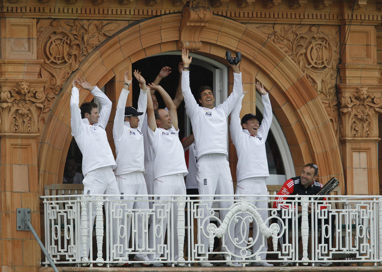 England players, Ian Bell (2ndL), Stuart Broad (3rdL), Jonathan Trott, Steven Finn (3rdR) and Eoin Morgan (2nd R) join in the mexican wave with the crowd from the players balcony during a rain delay against Sri Lanka, during Day 3 of the 2nd Test cricket match at Lord's Cricket ground in London, on June 5, 2011.   AFP PHOTO/ IAN KINGTON  EDITORIAL USE ONLY. NO ASSOCIATION WITH DIRECT COMPETITOR OF SPONSOR, PARTNER, OR SUPPLIER OF THE ECB (Photo credit should read IAN KINGTON/AFP/Getty Images)