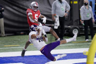 FILE - In this Dec. 19, 2020, file photo, Northwestern defensive back Brandon Joseph (16) intercepts a pass intended for Ohio State wide receiver Garrett Wilson (5) in the end zone during the first half of the Big Ten championship NCAA college football game in Indianapolis. Joseph was selected to The Associated Press Preseason All-America first team defense, Monday Aug. 23, 2021.(AP Photo/AJ Mast, File)