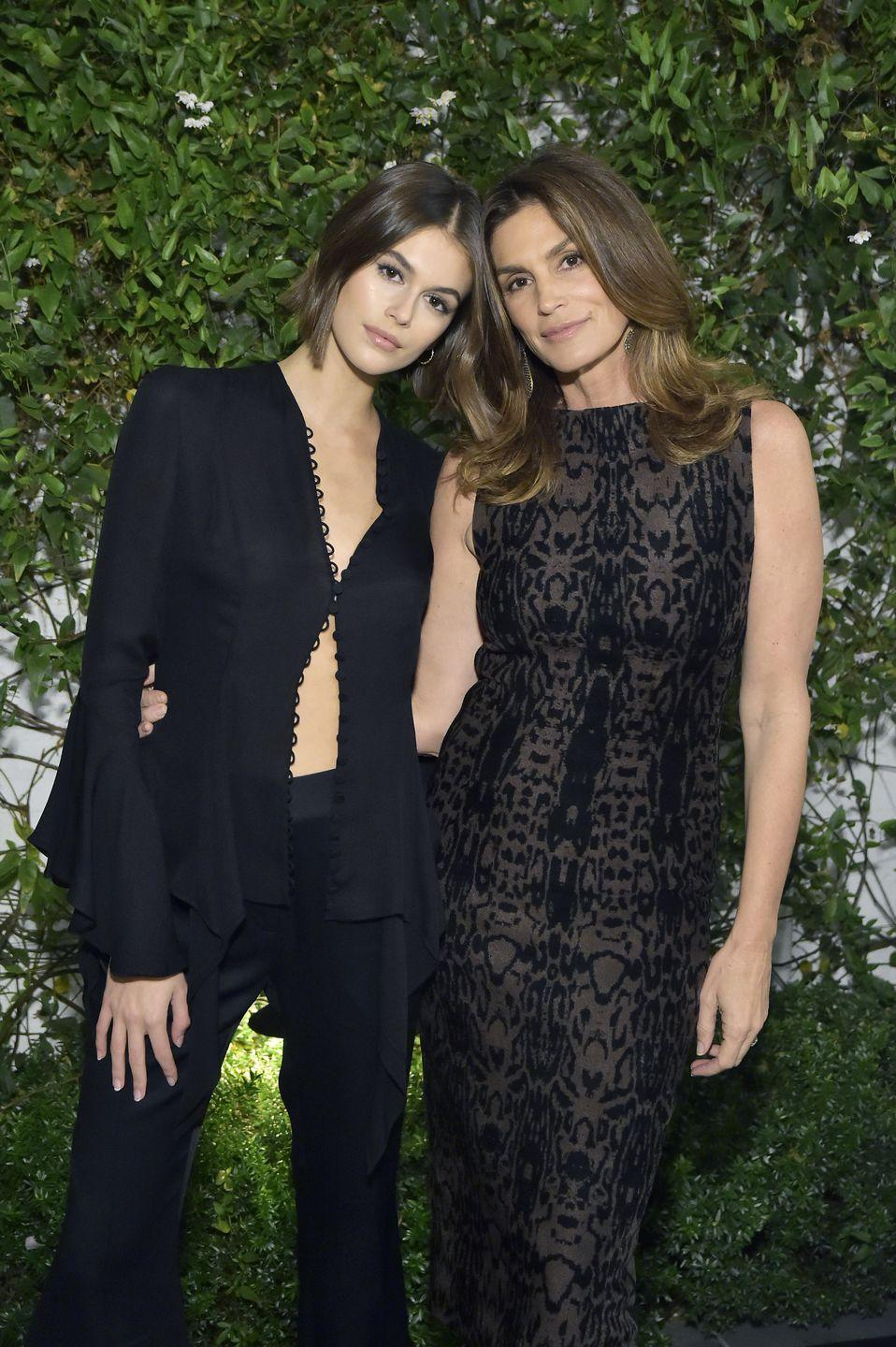 """<p>It's not hard to see why <a href=""""https://www.elle.com/uk/fashion/celebrity-style/g32572/kaia-gerber-best-runway-looks/?slide=1"""" rel=""""nofollow noopener"""" target=""""_blank"""" data-ylk=""""slk:Kaia Gerber"""" class=""""link rapid-noclick-resp"""">Kaia Gerber</a> and supermodel and actress Cindy Crawford have become successful supermodels, with their svelte figures, strong jawlines and perfectly-sculpted brows. </p><p>The 1990s catwalk star recently spoke out to <a href=""""https://www.elle.com/uk/fashion/celebrity-style/a29436305/kaia-gerber-cindy-crawford-defends-modeling/"""" rel=""""nofollow noopener"""" target=""""_blank"""" data-ylk=""""slk:explain why it was important"""" class=""""link rapid-noclick-resp"""">explain why it was important</a> to let her daughter pursue a modelling career. 'I had no trepidation at all about saying yes to Kaia,' the 'Super' said in October. 'I felt comfortable and I was like, """"Go for it, have fun and I'm always here if you have a question"""".'</p>"""