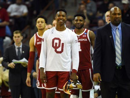 Mar 22, 2019; Columbia, SC, USA; Oklahoma Sooners forward Kristian Doolittle (21) celebrates with teammate during the second half against the Mississippi Rebels in the first round of the 2019 NCAA Tournament at Colonial Life Arena. Mandatory Credit: Bob Donnan-USA TODAY Sports
