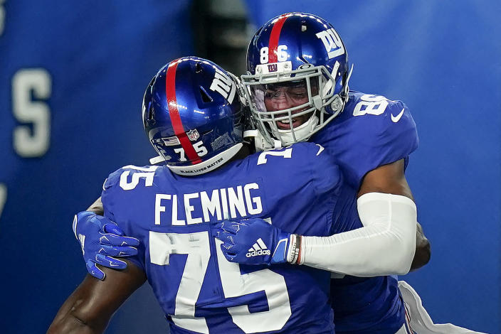 New York Giants wide receiver Darius Slayton (86) celebrates with offensive tackle Cameron Fleming (75) after scoring a touchdown against the Pittsburgh Steelers during the second quarter of an NFL football game Monday, Sept. 14, 2020, in East Rutherford, N.J. (AP Photo/Seth Wenig)