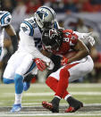 Atlanta Falcons wide receiver Roddy White (84) is hit by Carolina Panthers cornerback Bene' Benwikere (25) during the second half of an NFL football game, Sunday, Dec. 28, 2014, in Atlanta. (AP Photo/Brynn Anderson )