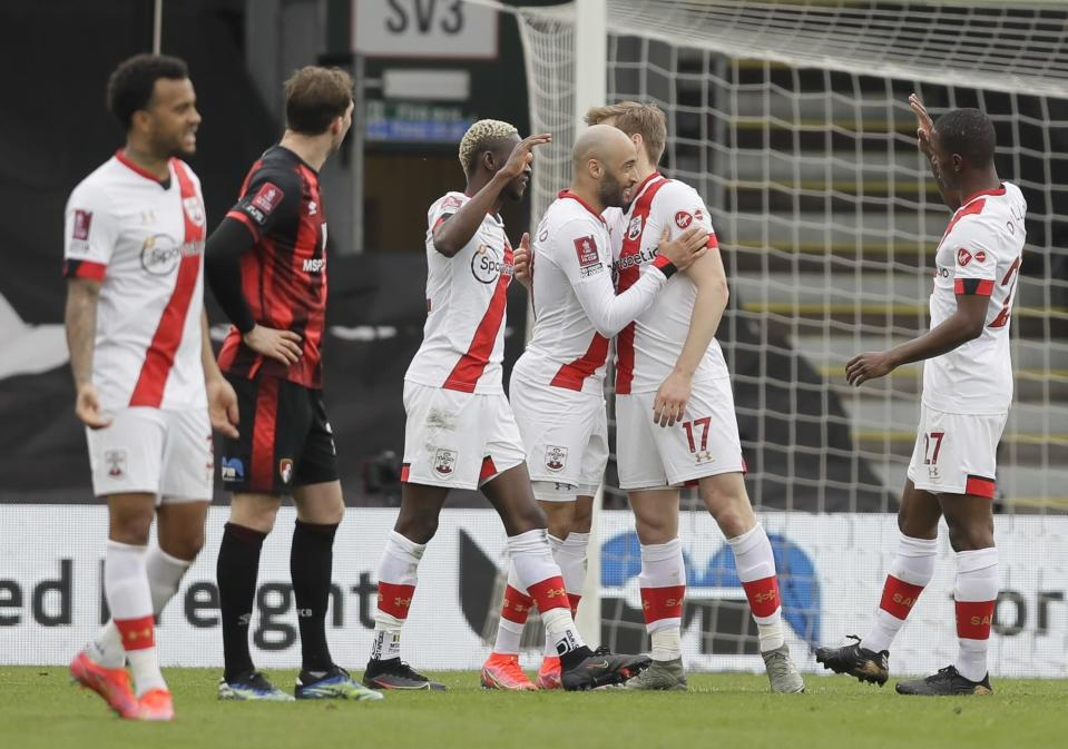 Southampton's Nathan Redmond, center, celebrates after scoring his side's third goal during the English FA Cup quarterfinal soccer match between Bournemouth and Southampton at Vitality Stadium in Bournemouth, England, Saturday, March 20, 2021. (AP Photo/Kirsty Wigglesworth)