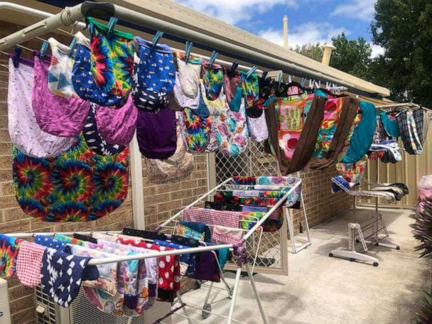 PHOTO: Various completed animal pouches for animals affected by Australia bushfires hang on clothing racks in this Jan. 4, 2020, image obtained via social media, in Regents Park, Queensland, Australia. (Kim Simeon via Reuters)