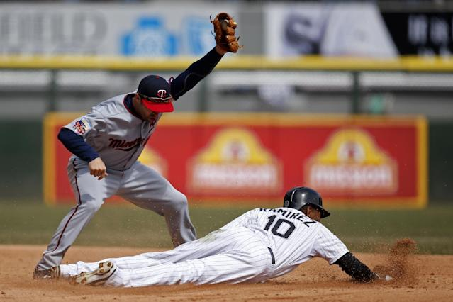 Chicago White Sox' Alexei Ramirez steals second under Minnesota Twins second baseman Brian Dozier during the fourth inning of a baseball game on Wednesday, April 2, 2014, in Chicago. (AP Photo/Andrew A. Nelles)