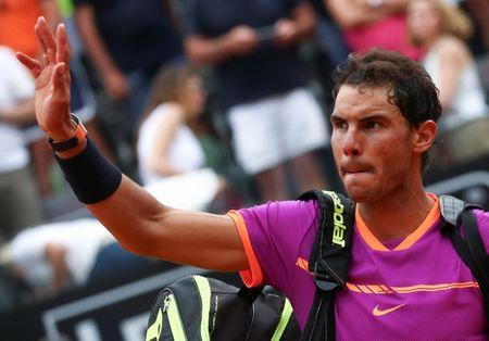 Tennis - ATP - Rome Open - Dominic Thiem of Austria v Rafael Nadal of Spain - Rome, Italy - 19/5/17 - Nadal waves as he leaves at the end of the match. REUTERS/Alessandro Bianchi