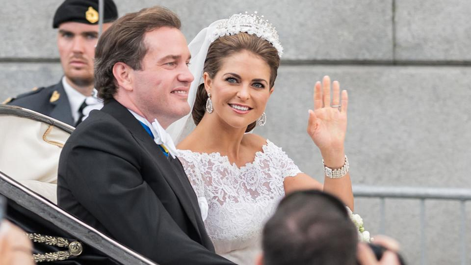 STOCKHOLM, SWEDEN - JUNE 8: Princess Madeleine and Chris O´Neill ride in a carriage on the way to Riddarholmen after their wedding in Slottskyrkan.