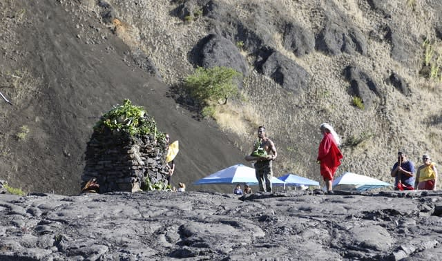 Native Hawaiian activists pray at the base of Hawaii's Mauna Kea on Sunday